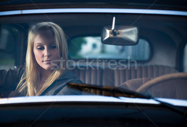 Portrait of a beautiful young blond in a vintage car. Stock photo © lithian