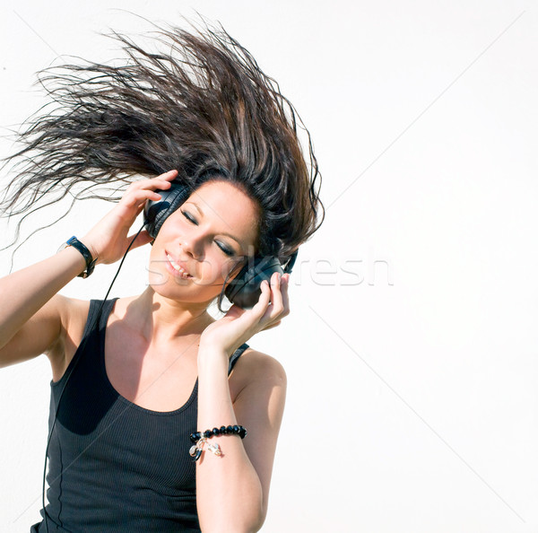 Hot young brunette musiclover. Stock photo © lithian