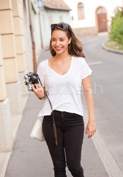 Brunette beauty taking photo. Stock photo © lithian