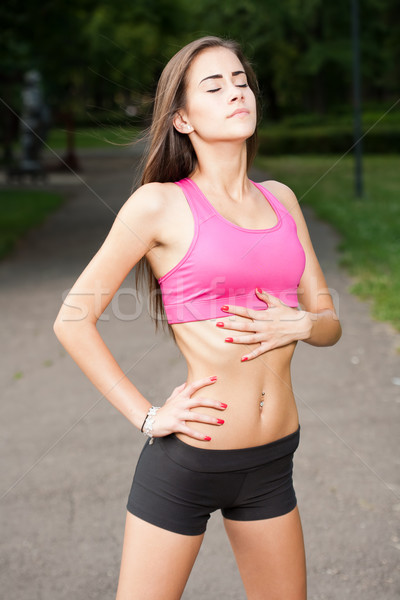 Young brunette fitness girl. Stock photo © lithian