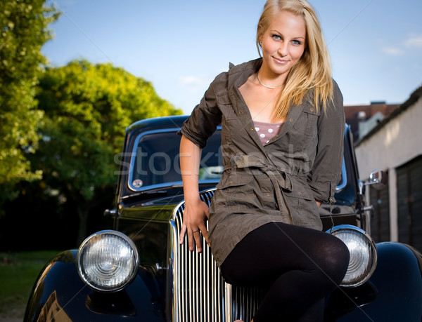 Beautiful young blond girl posing with a black vintage car. Stock photo © lithian