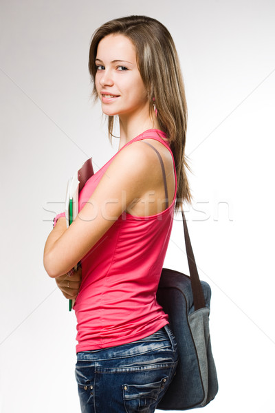 Attractive student girl wearing jeans. Stock photo © lithian