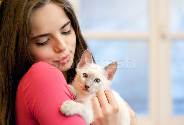Brunette beauty with cute kitten. Stock photo © lithian