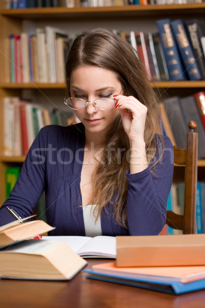 Busy young brunette student Stock photo © lithian