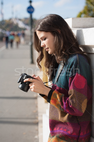 Cute young photographer. Stock photo © lithian