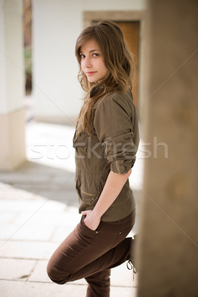 Stock photo: Gorgeous young brunette posing outdoors.
