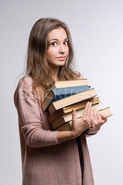 Nagy mennyiség tudás megrémült néz fiatal Stock fotó © lithian