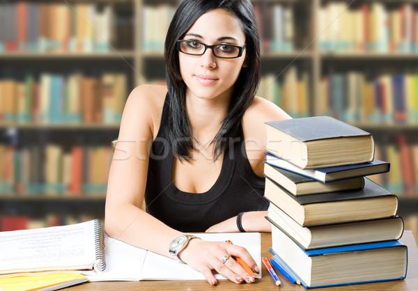 Gyönyörű fiatal diák portré lány könyvtár Stock fotó © lithian