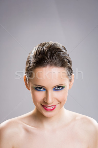 Brunette beauty in colorful makeup. Stock photo © lithian