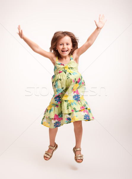Beautiful energetic young girl. Stock photo © lithian