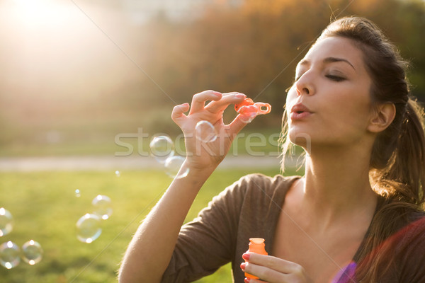 Blowing bubbles into the wind. Stock photo © lithian