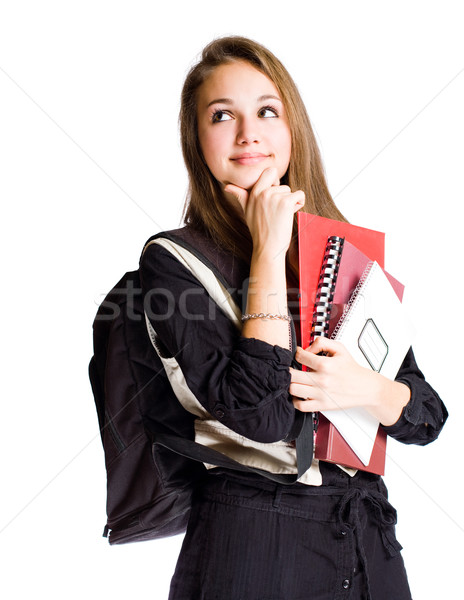 Cute young student girl pondering. Stock photo © lithian