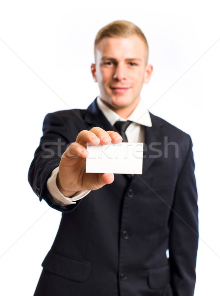 Young businessman doing his introduction. Stock photo © lithian