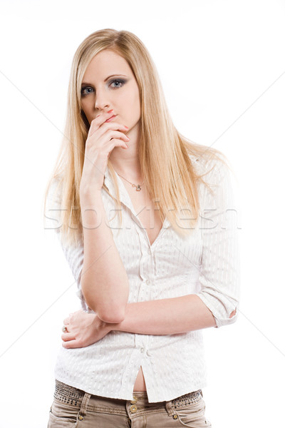 Beautiful young blond pondering. Stock photo © lithian