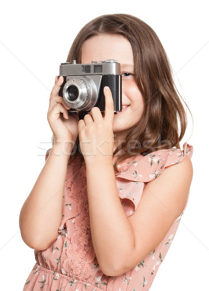 Young brunette girl with vintage camera. Stock photo © lithian
