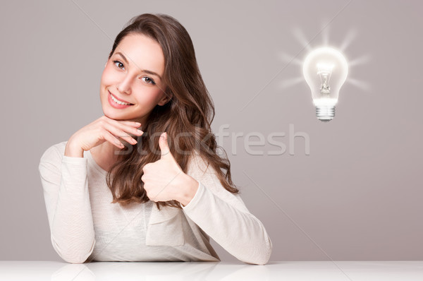 ストックフォト: 小さな · ブルネット · 美 · 電球 · シンボル · 肖像