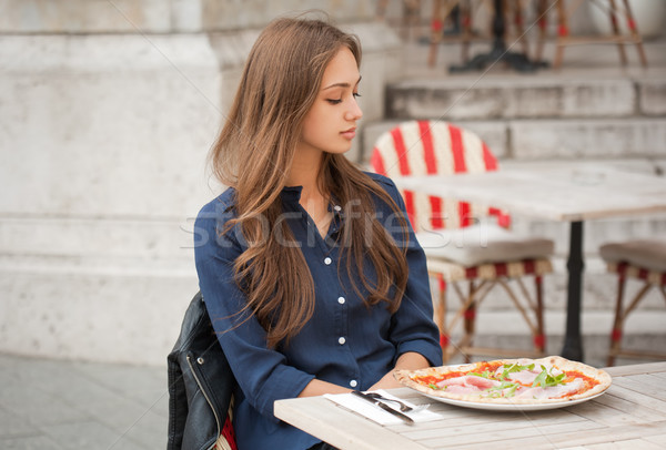 Young tourist woman eating authentic pizza outdoors. Stock photo © lithian