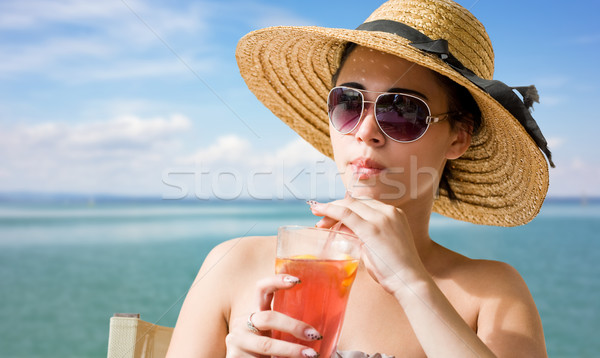 Young brunette with beach refreshment. Stock photo © lithian