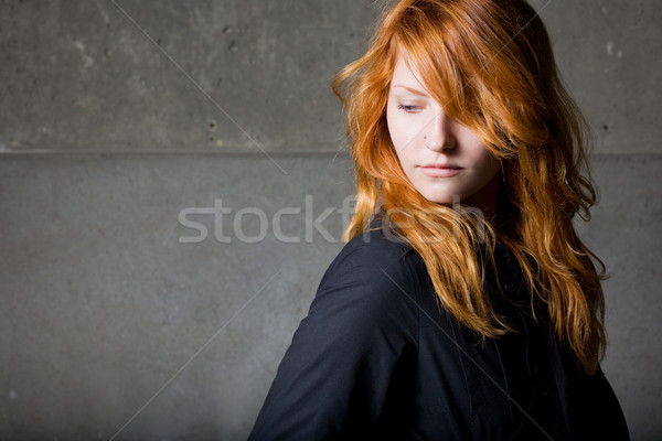 Moody portrait of a beautiful fashoinable young redhead girl wit Stock photo © lithian