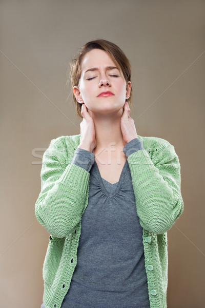 Neck pains. Stock photo © lithian