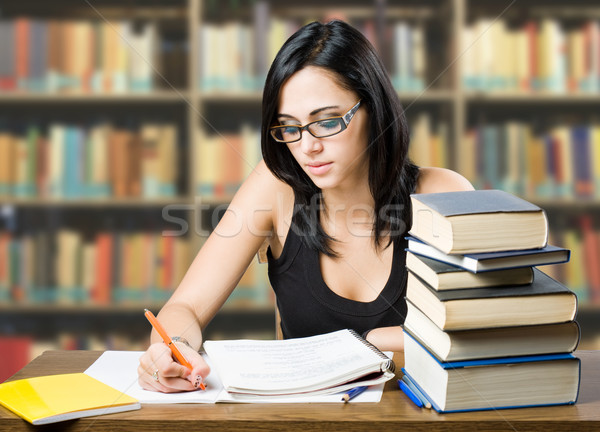 Attractive young brunette student girl. Stock photo © lithian