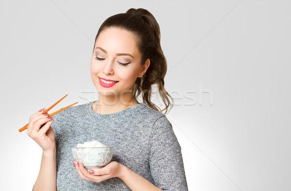 Aranyos barna hajú eszik ázsiai konyha portré káprázatos Stock fotó © lithian