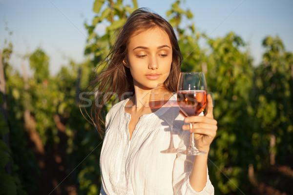 Gorgeous brunette woman having wine fun. Stock photo © lithian