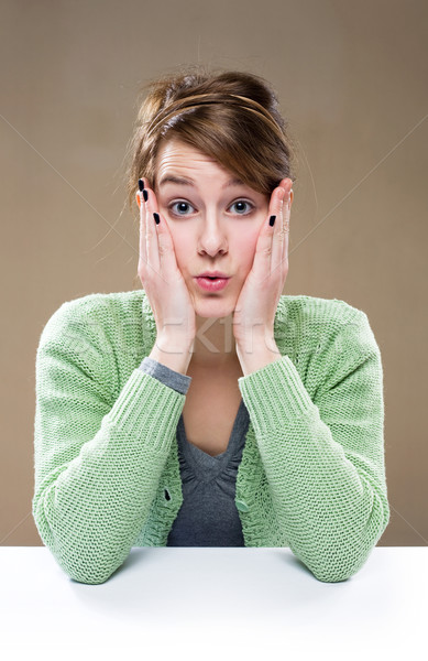 Shocked young woman. Stock photo © lithian