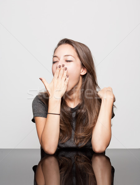 Cute gesturing brunette. Stock photo © lithian