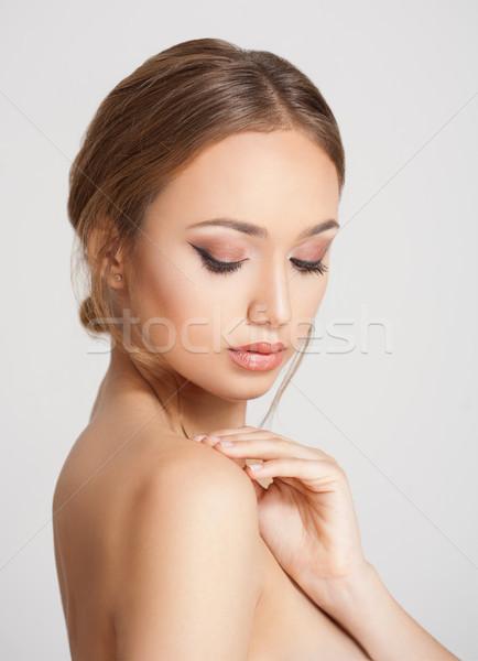Elegant makeup for brunette beauty. Stock photo © lithian