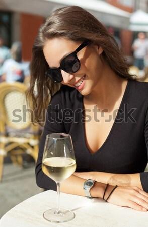 Stock photo: Brunette beauty having wine fun.