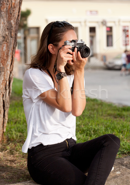 Brunette woman using analog camera. Stock photo © lithian