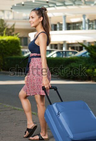 Young brunette woman with luggage. Stock photo © lithian