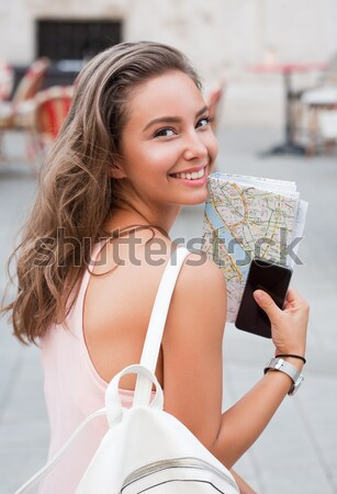 Beautiful brunette tourist woman. Stock photo © lithian