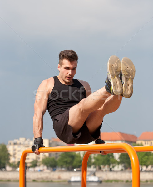 Outdoor workout on bars. Stock photo © lithian