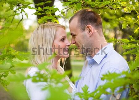 Attarctive young couple cuddling. Stock photo © lithian