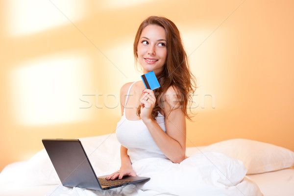 Brunette beauty with her laptop. Stock photo © lithian
