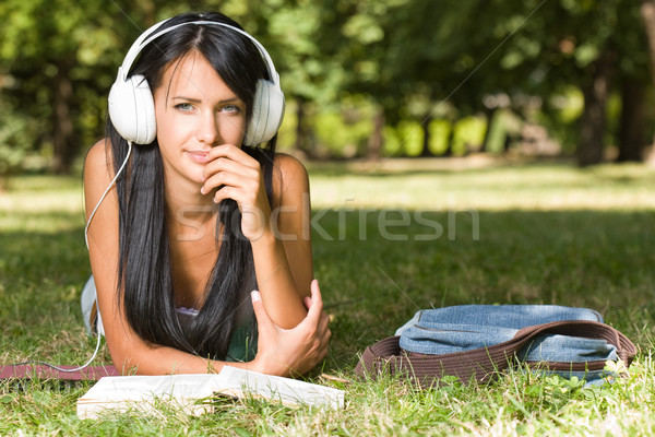 Gorgeous young relaxed student in the park. Stock photo © lithian