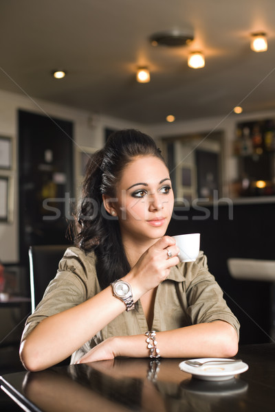 Fashionable young brunette woman having coffee. Stock photo © lithian