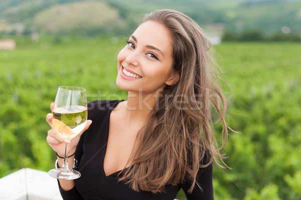 Stock photo: Wine tasting tourist woman.