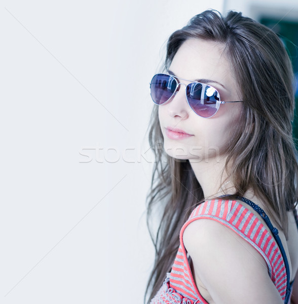 Grunge styled portrait of gorgoeus young brunette in sunglasses. Stock photo © lithian