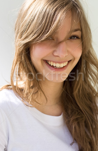 Stock photo: Beautiful young brunette with a big smile.