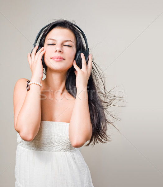 Beautiful brunette music lover. Stock photo © lithian