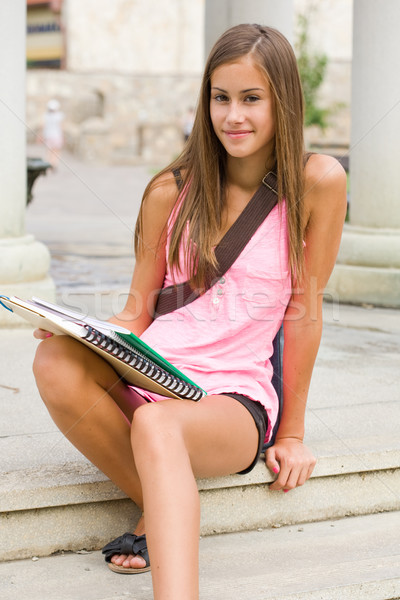Tanned young student girl. Stock photo © lithian
