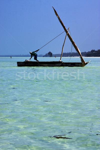 Plaży człowiek Tanzania łodzi wody drewna Zdjęcia stock © lkpro