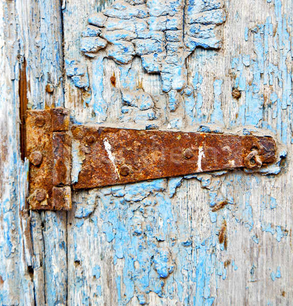 rusty metal     nail dirty stripped paint in the blue wood door  Stock photo © lkpro