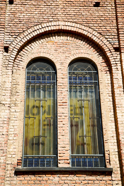 antique contruction in italy   rose window  wall Stock photo © lkpro