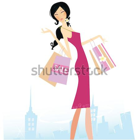 Shopper girl in pink dresscarrying shopping bags  Stock photo © lordalea