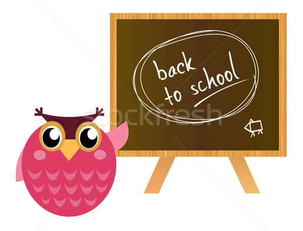 Pink Owl showing 'back to school' sign on black board