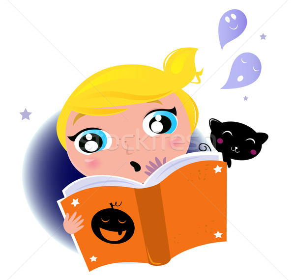 Cute little kid reading Halloween story book